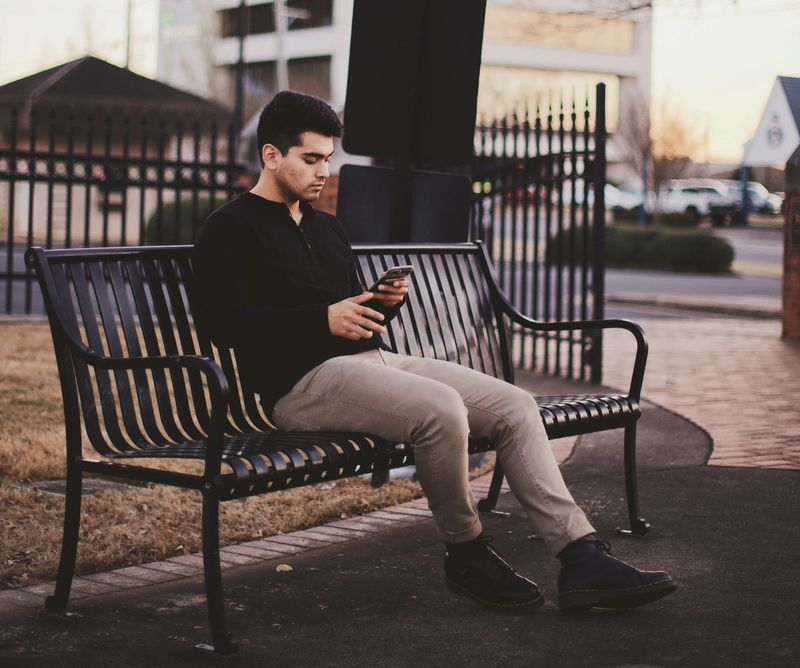 person sitting using their phone